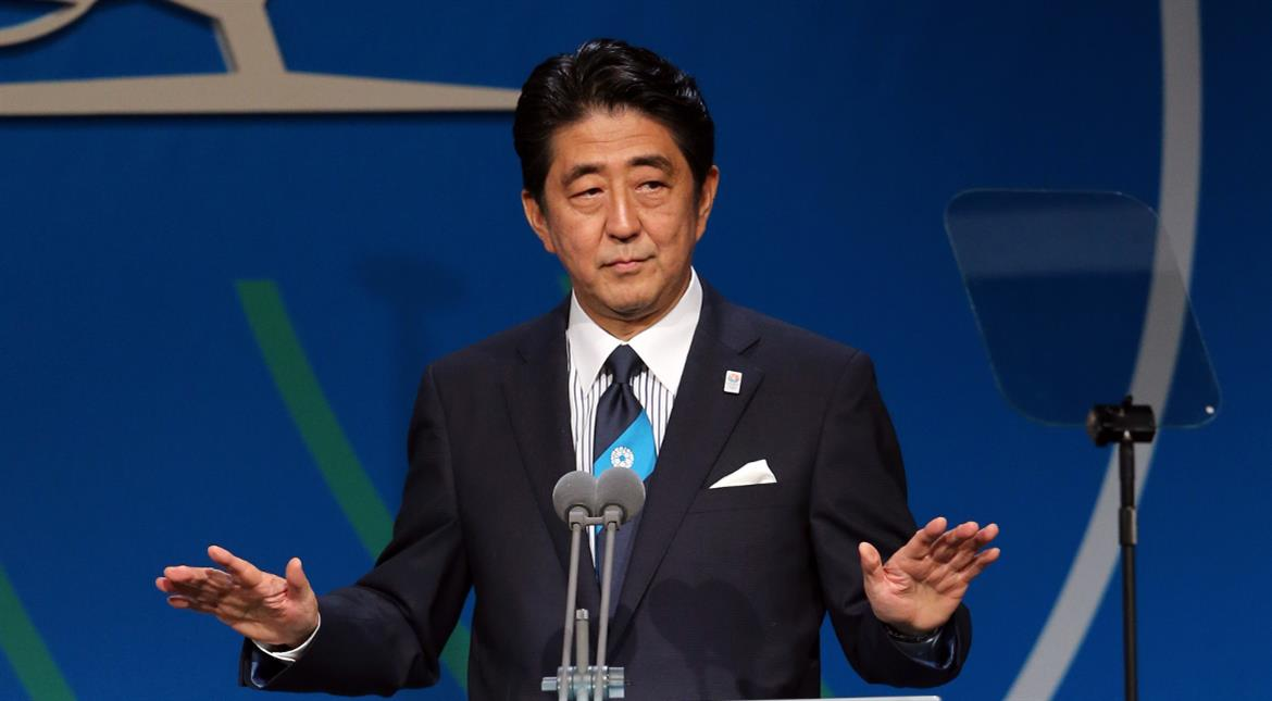 Japan ratifies TPP trade pact to fly flag for free trade