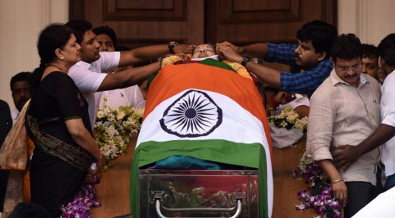 Sasikala stands beside Jayalalithaa's casket